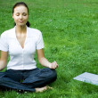 Meditating woman with laptop — Stock Photo #28270197