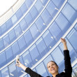 Businesswoman Raising Arms at Skyscraper — Stock Photo