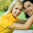 Smiling couple at park — Stock Photo