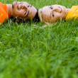 Stock Photo: Couple Lying on the Grass