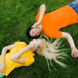 Couple lying on the grass with mobile phones — Stock Photo #28270847