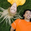 Couple Lying on the Grass — Stock Photo #28270877