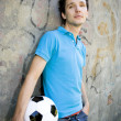 Young man holding soccer ball — Photo