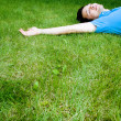 Young man lying on the grass — Stock Photo