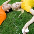 Stock Photo: Couple listening to MP3 player