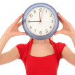 Woman with clock covering face — Stock Photo