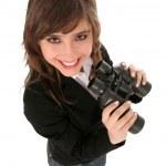 Businesswoman holding binoculars — Stock Photo