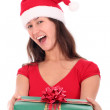 Stock Photo: Woman in Santa hat holding gift box
