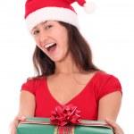 Woman in Santa hat holding gift box — Stock Photo