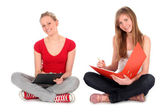 Young women doing homework — Stock Photo