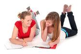 Young women doing homework — Stock Photo