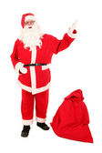 Santa Claus carrying bag of Christmas gifts — Stock Photo