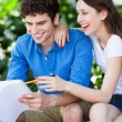 Student couple learning outdoors — Stock Photo #28520079