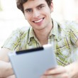 Young man with digital tablet — Stock Photo #28520121
