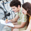 Foto de Stock  : Student couple learning outdoors