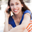 Teenage girl talking on a mobile phone — Foto de Stock