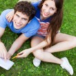 Student couple learning outdoors — Stock Photo #28520307
