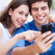 Young people with mobile phone — Stock Photo
