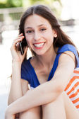 Teenage girl talking on a mobile phone — Stock Photo