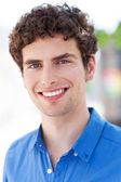 Young man smiling — Stock Photo