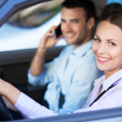 Young couple sitting in car — Stock Photo #29540513
