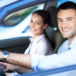 Young couple sitting in car — Stock Photo #29540581