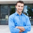 Stock Photo: Young man smiling