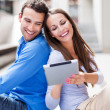 Foto Stock: Young couple with digital tablet
