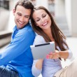 Foto de Stock  : Young couple with digital tablet