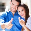 Smiling couple with thumbs up — Stock Photo #29541025