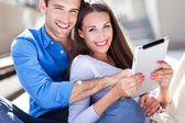 Young couple with digital tablet — Stock Photo
