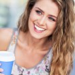 Stock Photo: Womoutdoors with coffee