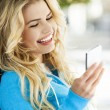 Stock Photo: Woman happy, holding phone