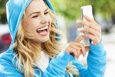 Woman happy, holding phone — Stock Photo