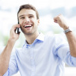 Excited man with mobile phone — Stock Photo