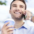 Man with coffee and mobile phone — Stock Photo
