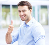 Man showing thumbs up — Foto de Stock