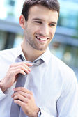 Businessman adjusting his tie — Stock Photo