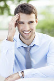 Businessman smiling — Stock Photo