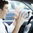 Frustrated man driving car — Stock Photo #33434433