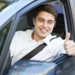 Man in a car with thumbs up — Stock Photo