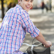 Man riding a bike in the city — Stock Photo