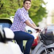 Young man on bike — Stock Photo
