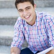Male student smiling — Foto de Stock