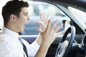 Frustrated man driving car — Stok fotoğraf