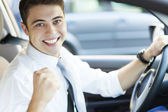 Excited man in car — Stock Photo