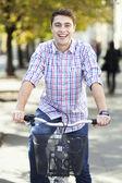 Young man on bike — Stock Photo