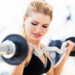Woman lifting weights — Stock Photo #34820363
