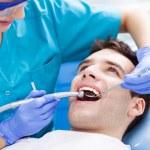 Man having teeth examined at dentists — Stock Photo