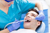 Man having teeth examined at dentists — Stock Photo